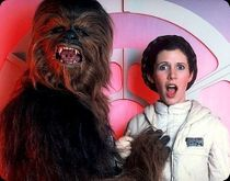 A humorous behind-the-scenes image of Chewbacca groping Leia.