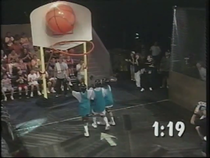 Screenshot of 3 contestants playing with a humongous basketball from the Best of Nickelodeon Studios video.