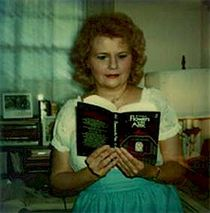 1978 photo of V.C. Andrews holding a copy of Flowers in the Attic.