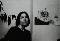 Photograph of Nancy Edell with some artwork.