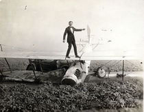 A (tragically ironic) promotional photo for the film, of Ormer Locklear atop a totalled biplane.