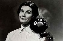 Jean Marsh (Left) and Grover (Right) appear in a framing segment.